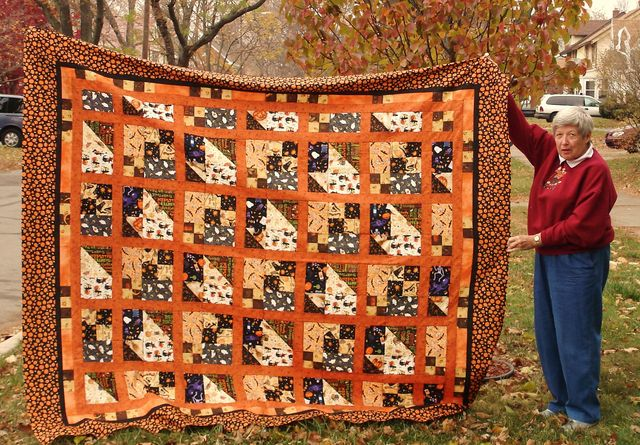 Erik's mom and her Halloween Scrap Pile Mystery Quilt