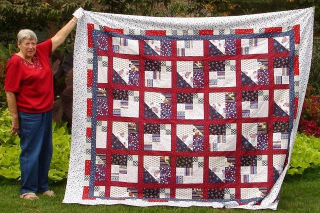 Erik's mom's Scrap Pile Mystery Quilt in red, white, and blue